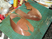 Hand-Stitching The Apron: By Enrile